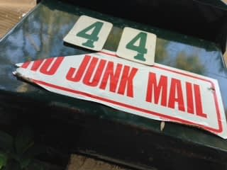 A letter box with the number 44 and a sticker with the words, no junk mail.